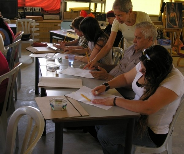 Smadar instructing drawing class